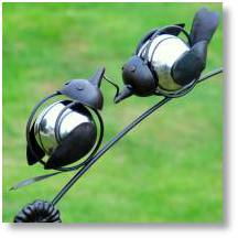 Balancing birds by Advocado Stone on sale at Buckingham Garden Centre