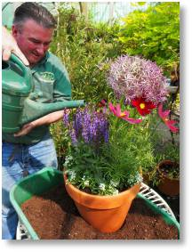 Chris Day, of Buckingham Garden Centre, demonstrates how top plant up a pot for attracting pollinating insects